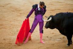 The barefoot bullfighter Stock Image