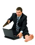 Barefoot businessman saw laptop isolated on white Royalty Free Stock Images