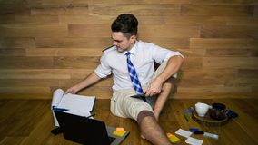 Young man remote working at home in funny clothes royalty free stock images