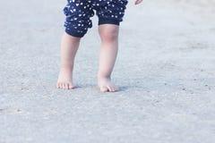 Barefoot child legs Stock Photography