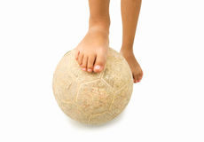 Barefoot child playing football Royalty Free Stock Images