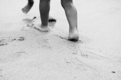 Barefoot children in the shallow sea Stock Photo