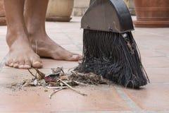 Barefoot closeup sweeping outdoor patio floor Royalty Free Stock Photo