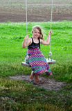 Barefoot country girl on swing Stock Image