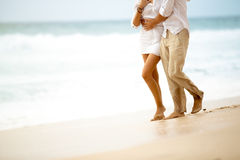 Barefoot couple walking on beach. Barefoot couple in relaxing walk on beach Royalty Free Stock Image