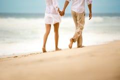 Barefoot couple walking on beach Royalty Free Stock Photo