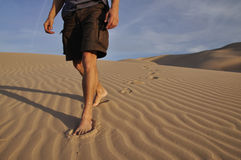 Barefoot desert hiker Stock Photos