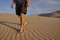 Barefoot desert hiker Stock Photos
