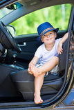Barefoot driver in car Royalty Free Stock Photography