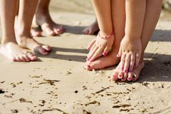 Barefoot family in the sand Stock Image