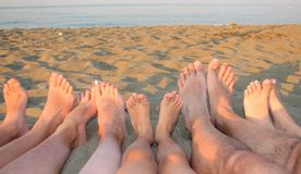 Barefoot of a family on the shore of the sea on the beach Royalty Free Stock Images