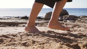 Barefoot feets of boy running at the beach stock footage