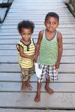 Barefoot fisherman´s kids Royalty Free Stock Image