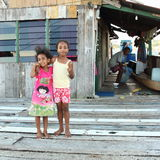 Barefoot fisherman´s kids Royalty Free Stock Photos