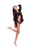 Barefoot girl in black lingerie Stock Photo