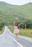 Barefoot girl with chamomile bouquet runs along dividing line Stock Photo
