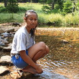Barefoot girl by creek Stock Images