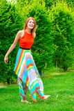 Barefoot girl in a dress on a lawn Stock Photography