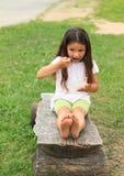 Barefoot girl eating Royalty Free Stock Photos