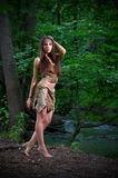 Barefoot girl in forest Royalty Free Stock Photo