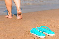 Barefoot girl goes without shoes Stock Images