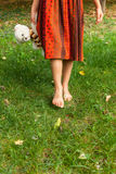 Barefoot girl in grass Royalty Free Stock Photos