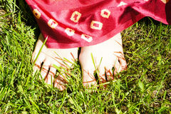 Barefoot girl on grass Royalty Free Stock Photo