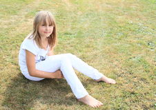 Barefoot girl on meadow Royalty Free Stock Photography