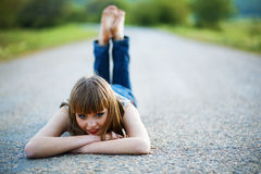 Barefoot girl on road Stock Photo