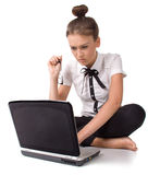 Barefoot girl sitting on the floo and works Royalty Free Stock Photo