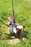 Barefoot girl on a swing Royalty Free Stock Photo