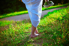 Barefoot girl walking  in the park Royalty Free Stock Photos