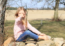 Barefoot girl on wall Royalty Free Stock Photography