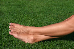 Barefoot in the Grass Stock Images