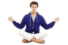 Barefoot handsome man in yoga position Stock Images