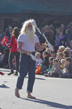 Barefoot Juggler in the Christmas Parade Royalty Free Stock Images