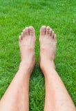 Barefoot Legs. On the Green Grass in Garden Stock Photo