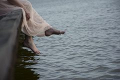 Barefoot legs on the lake Stock Photography