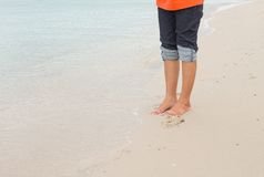 Barefoot legs walking in the seashore, Vacation on summer sea Royalty Free Stock Photo