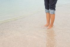 Barefoot legs walking in the seashore, Vacation on summer sea Stock Photos
