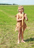 Barefoot little girl with bow Royalty Free Stock Photos