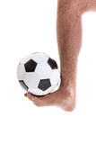 Barefoot man playing soccer on white background Royalty Free Stock Image