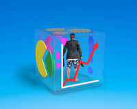 Barefoot man with shorts standing in glass cube Stock Images