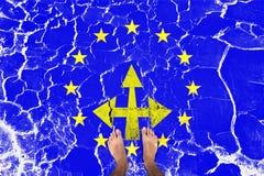 Barefoot man standing on cracked eu flag Stock Photo