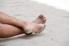 Barefoot man in the street Royalty Free Stock Photos