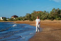 Barefoot man walking on the waves of the surf royalty free stock image