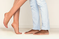 Barefoot man and woman on tiptoe Royalty Free Stock Photos