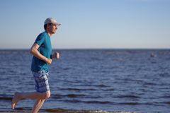 Jogging on a beach Stock Images