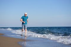 Jogging on a beach Stock Photo