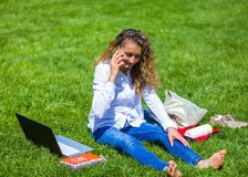 I love my work!. Barefoot online seller pretty woman sitting outdoor with her tools Stock Images